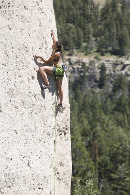 Side view of woman climbing mountain