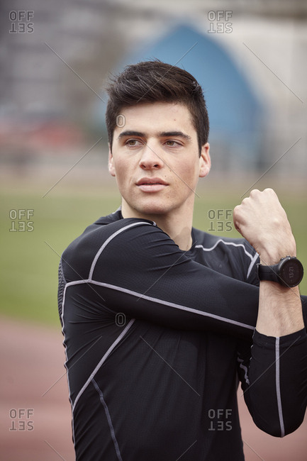 Male athlete exercising on sports track