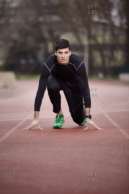 Portrait of male athlete at starting line