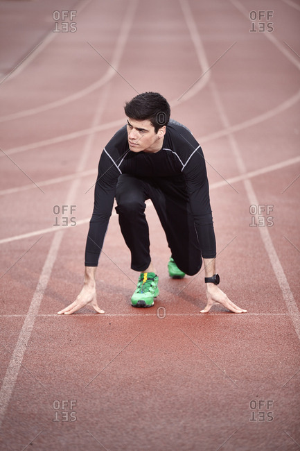 High angle view of male athlete at starting line
