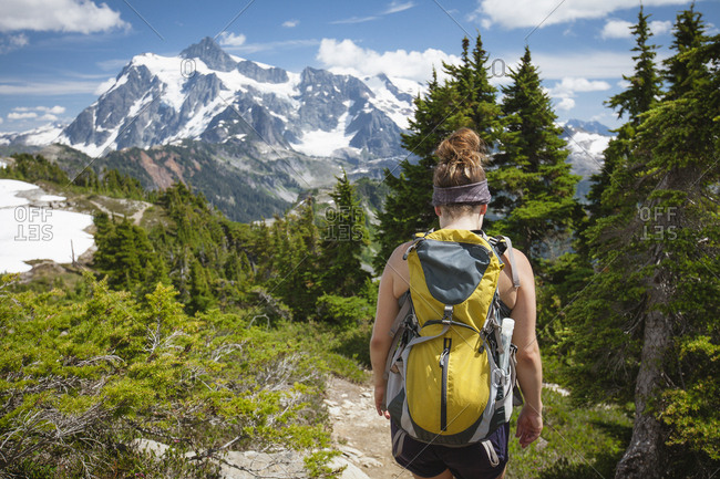 Rear view of female hiker with backpack walking at North Cascades National Park
