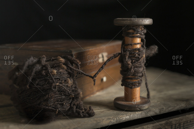 Close-up of yarn and wooden spool on table