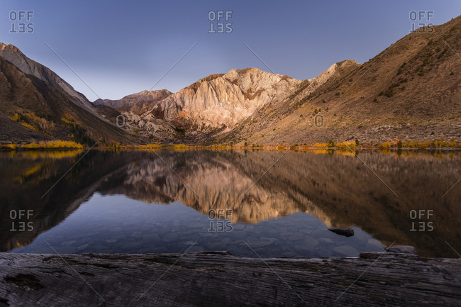 Scenic view of calm Convict Lake by mountains against sky