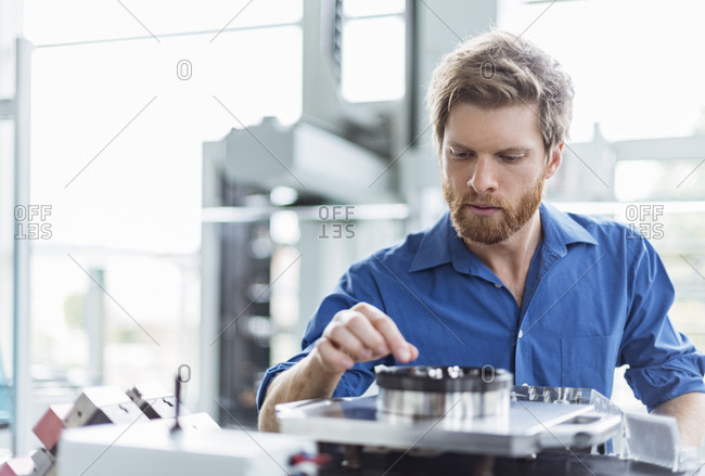 Man examining product in company