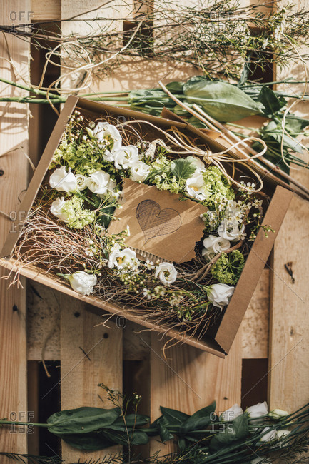 Floral arrangement in cardboard box