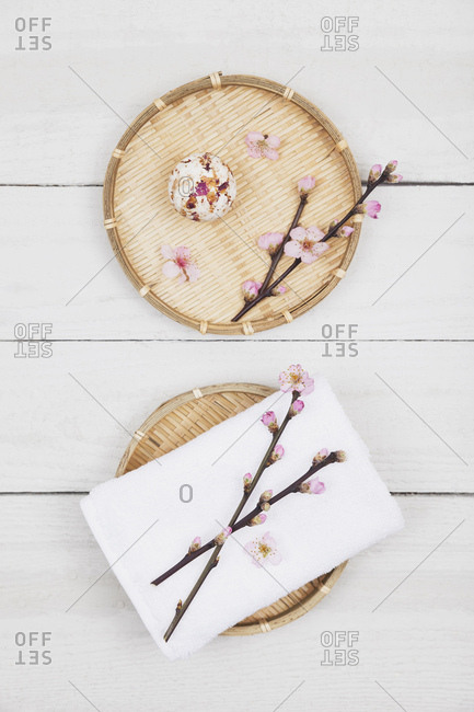 Cherry blossom soap ball and towel on bamboo trays