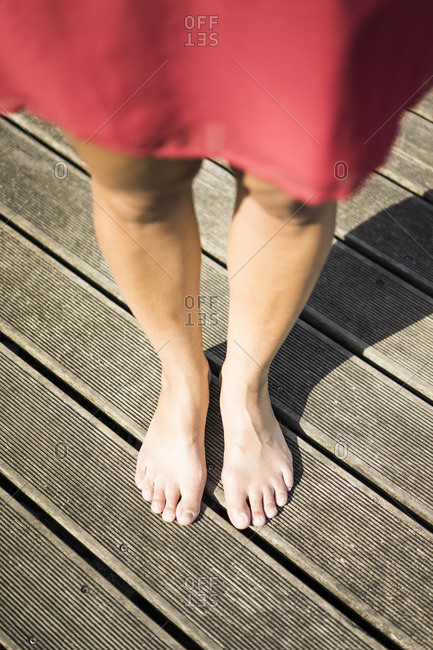Feet of woman standing on deck