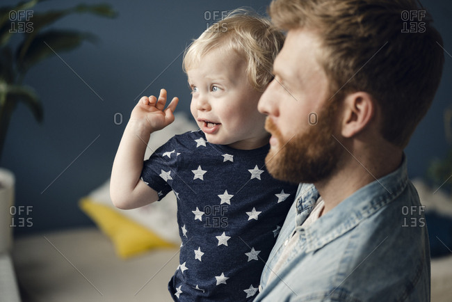 Father spending time with his son at home