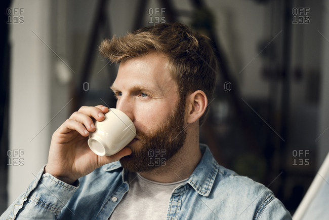 Man relaxing at home- drinking coffee