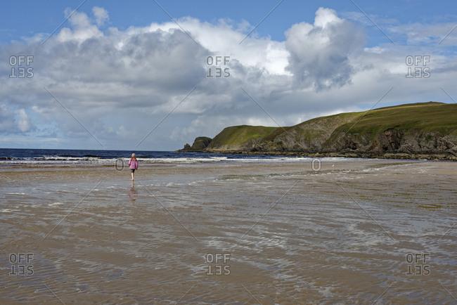 United Kingdom- Scotland- Highland- Sutherland- Bettyhill- girl walking at beach