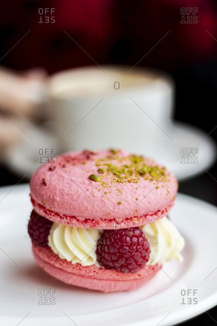 Macaron filled with fresh raspberries and cream