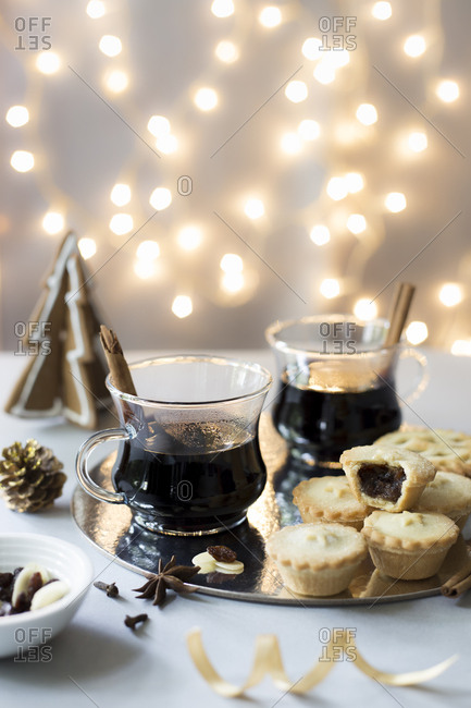 Christmas glogg mulled wine with mince pies with missing bite