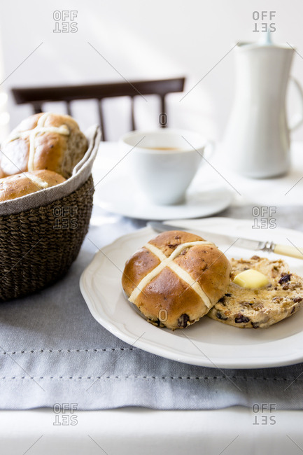 Hot cross buns with melted butter for breakfast