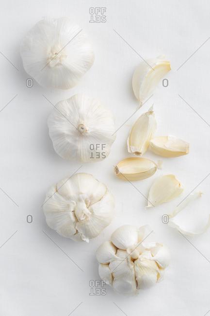 Garlic bulbs and garlic cloves overhead view