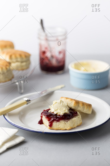Baked scones with jam and clotted cream