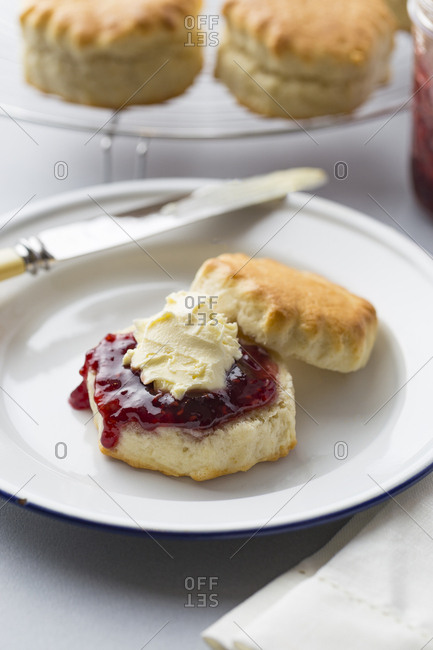 Baked scones with jam and clotted cream, up close