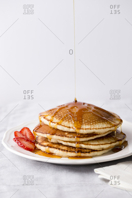 Pancake with syrup drizzling