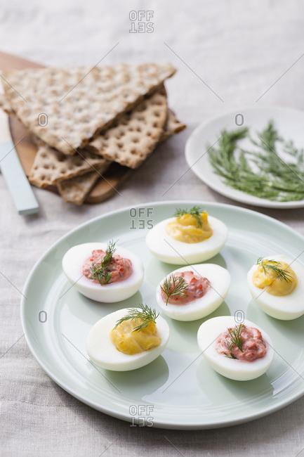 Beetroot & swedish caviar deviled eggs with crispbread