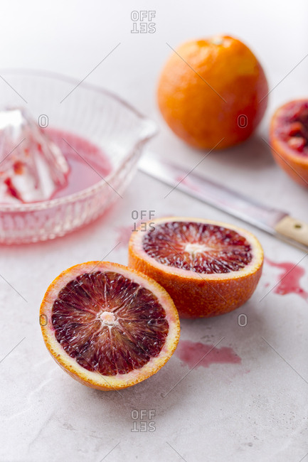 Blood oranges halved and juiced