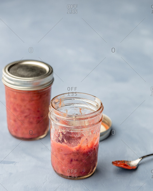 Rhubarb jam jars with spoon on the side