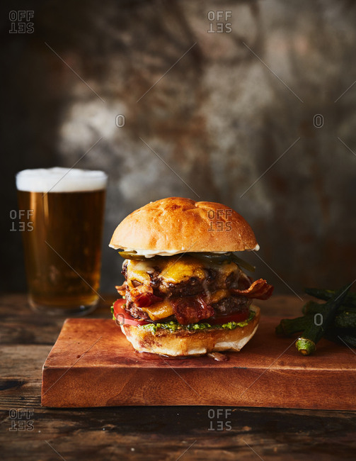 Hamburger served with a glass of beer