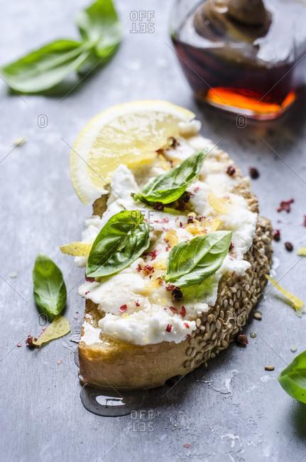 Bruschetta with ricotta, red pepper, lemon zest and chestnut honey
