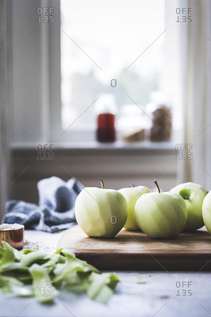 Fresh peeled apples on a chopping board