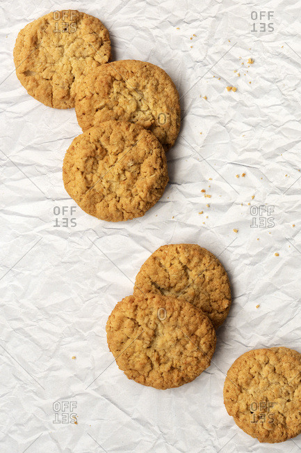 Six honey and oatmeal biscuits on a textured paper background