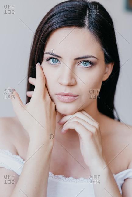 Portrait of beautiful brunette woman with blue eyes