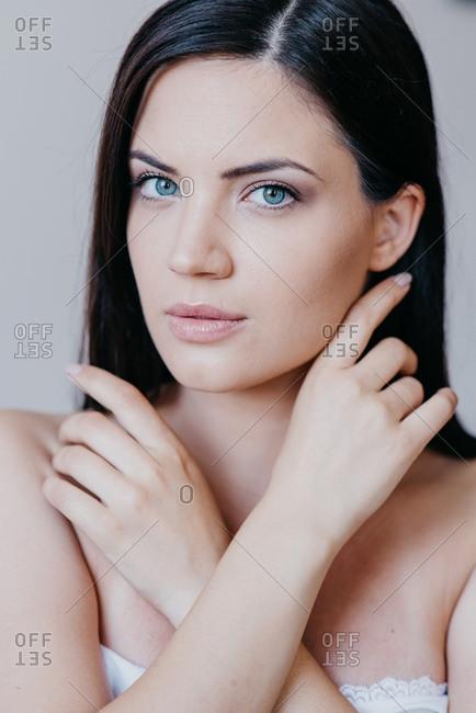 Portrait of pretty brunette woman with blue eyes