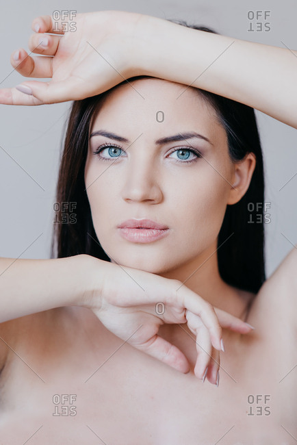 Portrait of beautiful brunette woman with blue eyes and fresh skin