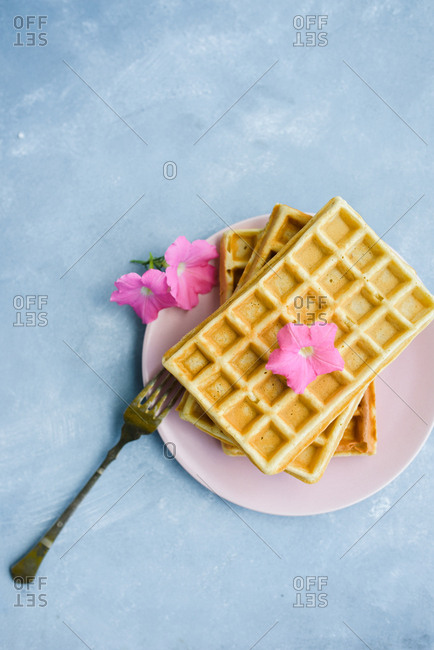 Waffles on a plate on a blue background