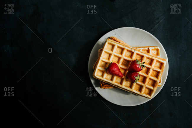 High angle view of waffles with strawberries
