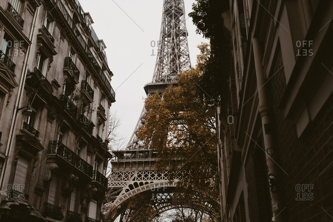 View of the Eiffel Tower through buildings