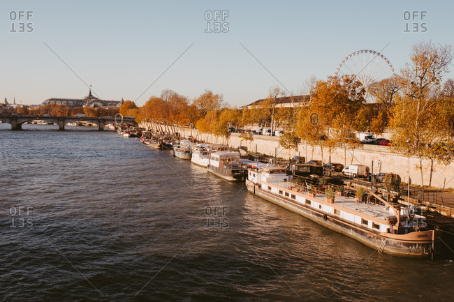 November 22, 2017: View of big wheel and houseboats from across the Seine, Paris