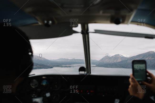 People flying in a bush plane over Alaska