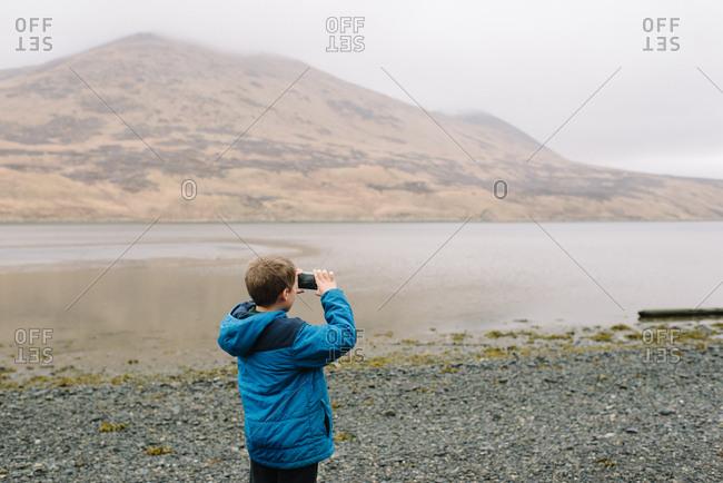 Child taking pictures in rural Alaska