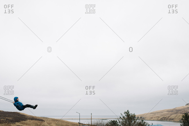 Child swinging in rural Alaska