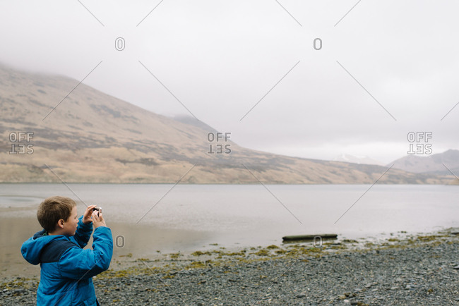 Boy taking pictures in rural Alaska
