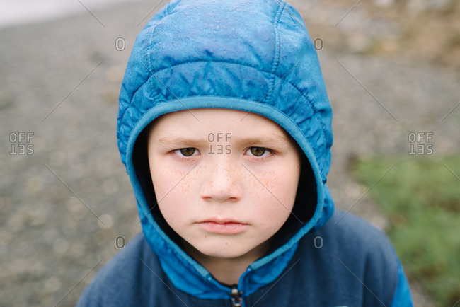 Portrait of a young boy wearing a blue jacket
