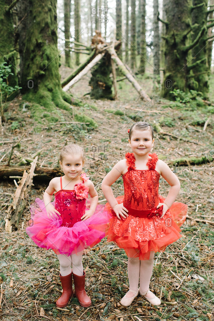 Little girls in ballerina outfits in the woods