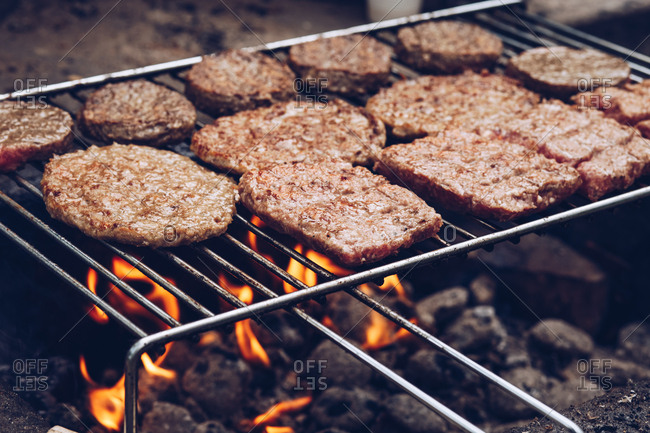 Burgers cooking on an outdoor grill