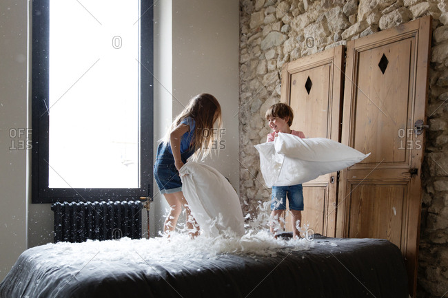 Siblings kids having a pillow fight