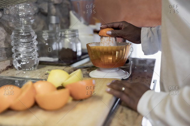 Brazilian woman preparing a fresh juice at home