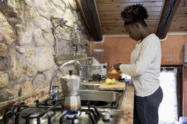 Woman preparing a fresh juice at home