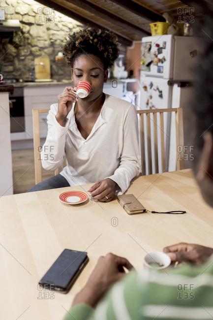 Brazilian couple having coffee at home