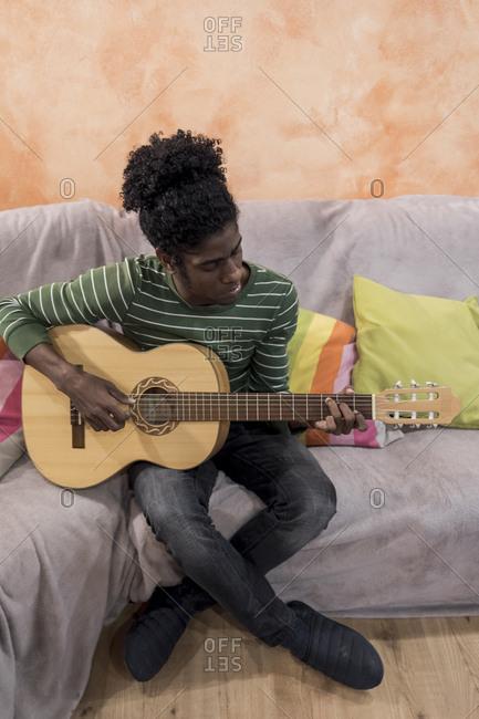 A Brazilian man playing an acoustic guitar