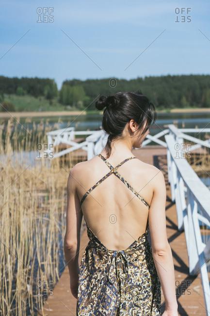 Woman on a lake dock