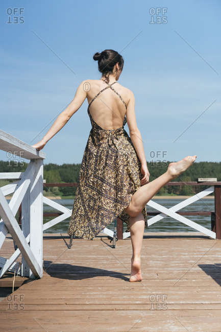 Dancer on a lake dock