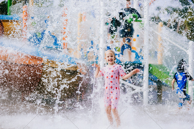Girl playing in the water at a water park